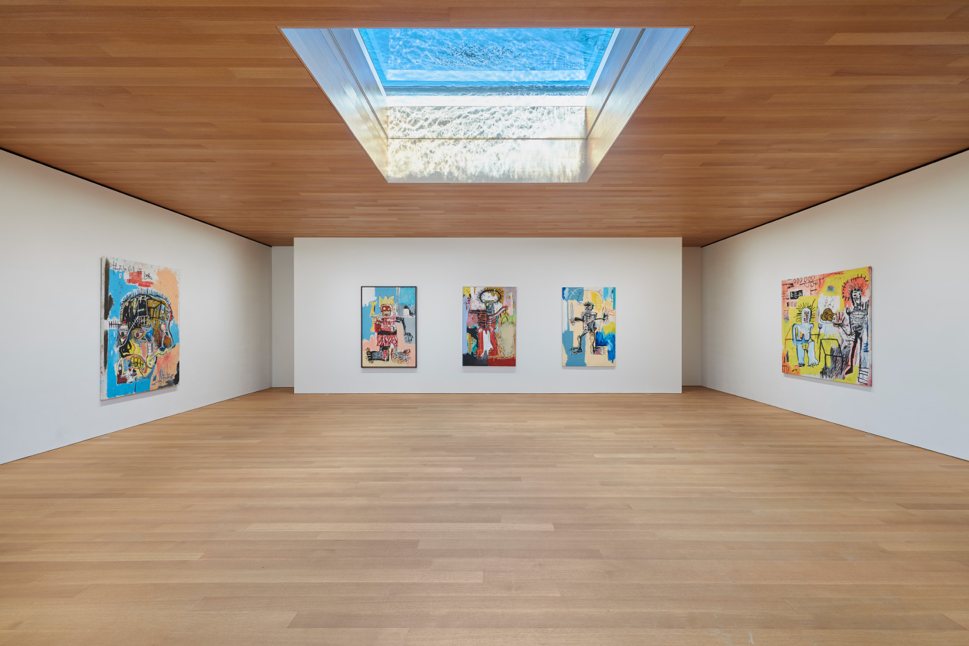 Interior photo of the Brant Foundation galleries, with an aquarium skylight distorting the light