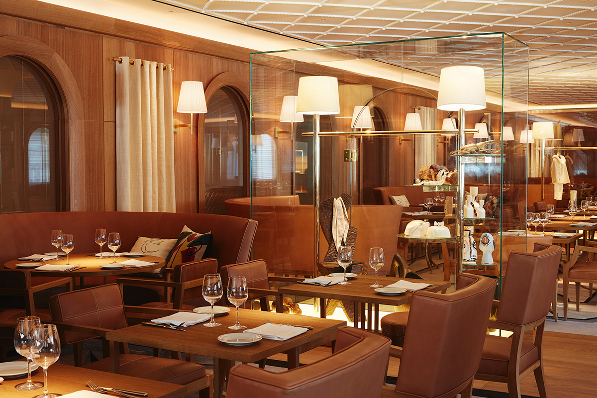 Image of interior of a beige-colored restaurant with wood, L'Avenue
