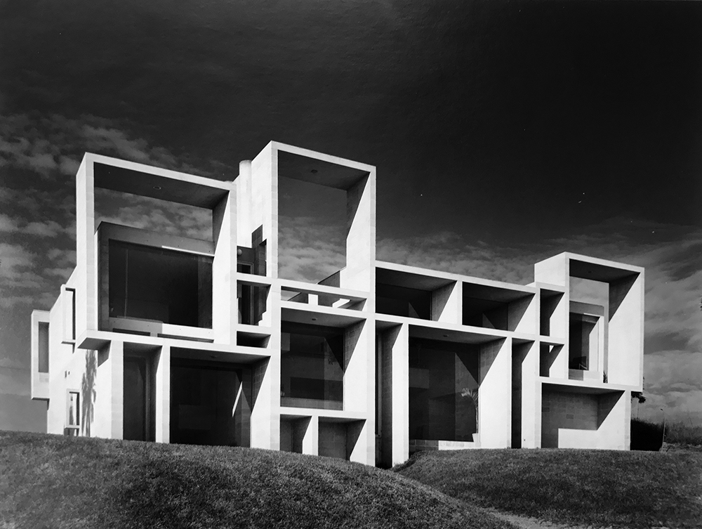 Black and white photo of a boxy Brutalist concrete home, the Paul Rudolph-designed Milam Residence