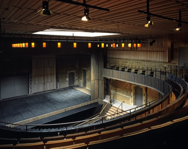 The interior of a subdued opera house