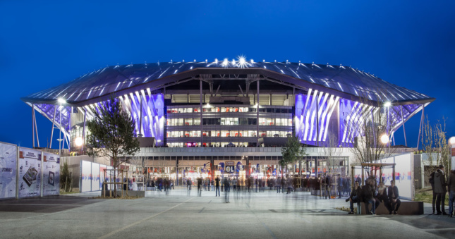 Night shot of stadium lit up with purple lights