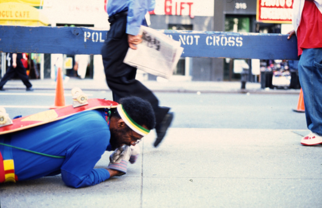 A man crawling across the ground
