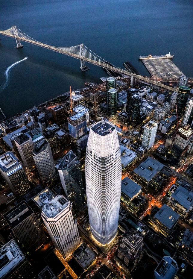 Aerial photo of a glassy tower from above