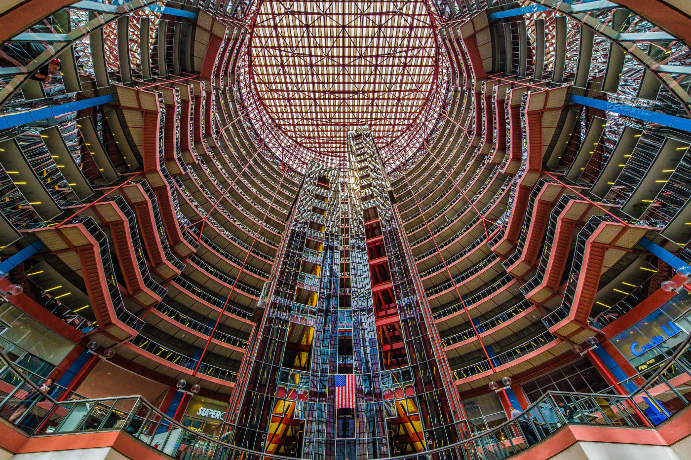 Looking up through the multicolored glass of the Thompson Center atrium