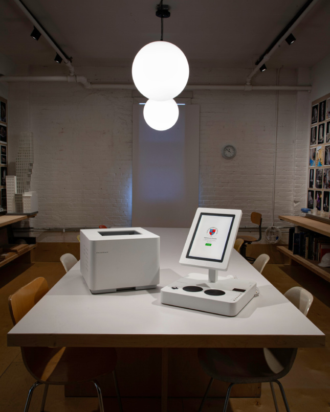 A sleek printer and tablet attached to a voting pad