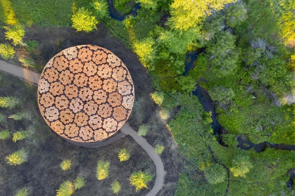 Aerial photo of Francis Kéré's pavilion made from timber logs