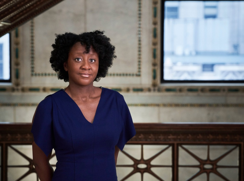 Photo of an African American woman, Yesomi Umolu, curator of the Chicago Architecture Biennial.