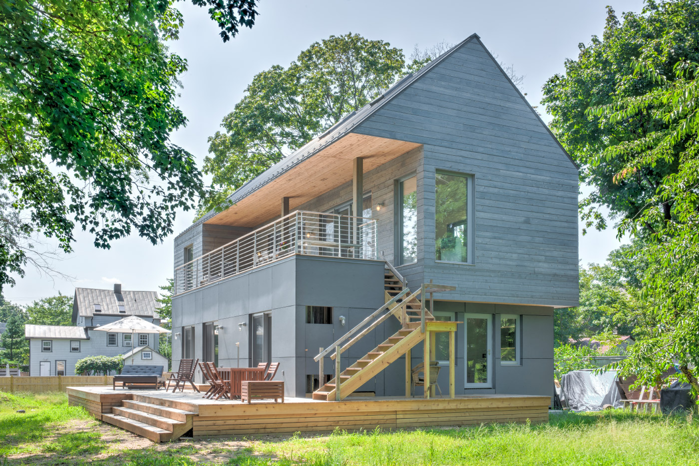 A two-story passive house clad in timber on North Fork