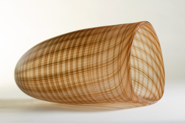 A glass vessel with a textured patterns