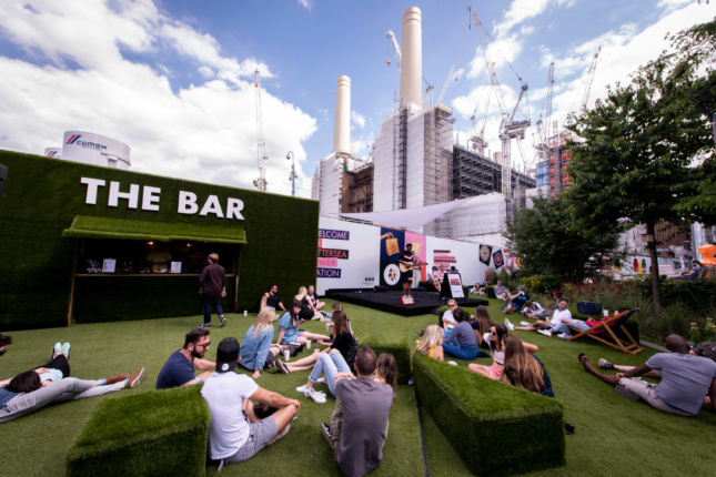 A public green space with smokestacks