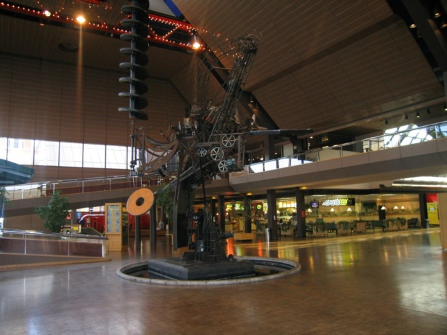 An interior image of Jean Tinguely's sculpture in the atrium of César Pelli's The Commons in Columbus, Indiana.