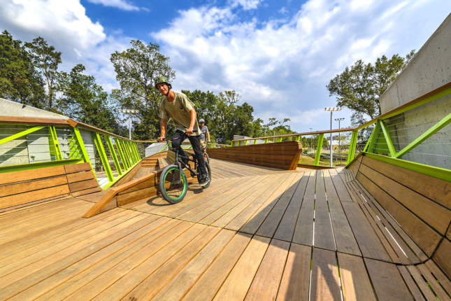 Image of biker of wooden bridge with green steel rails