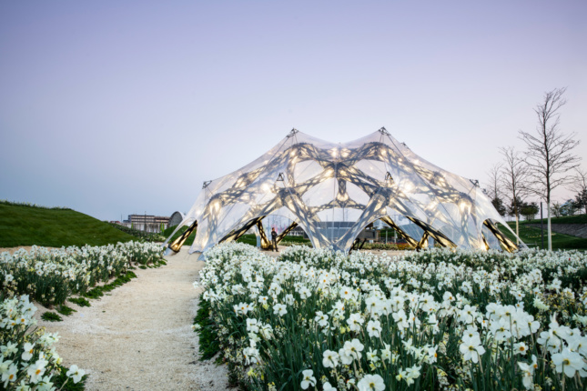 A pavilion with a clear skin in a field of flowers, for the BUGA horticulture show