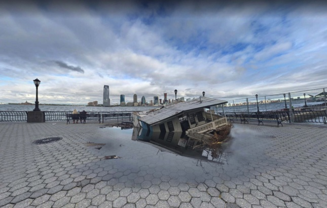 A damaged house sinks into the promenade at Battery Park City.
