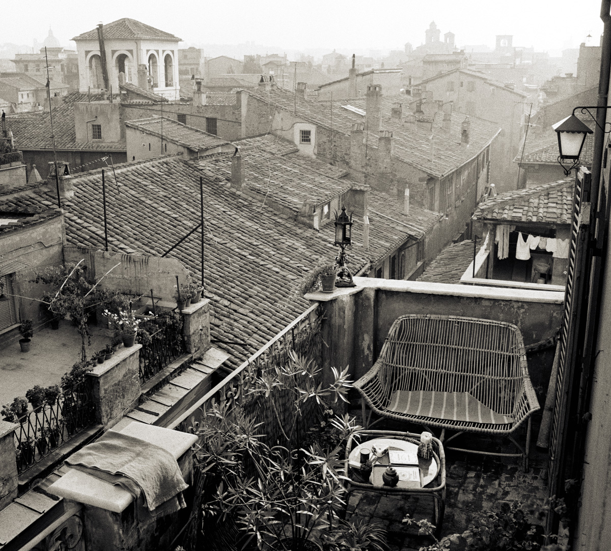 Black and white photo of rooftops in Rome, from the show and book