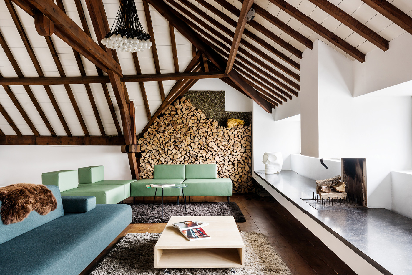 Interior of a white loft with exposed timber beams, the new home of Lensvelt
