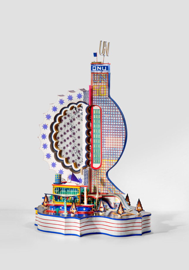 Photo of a sculptural building made from waste paper
