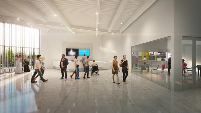 People walking inside of a white arts space