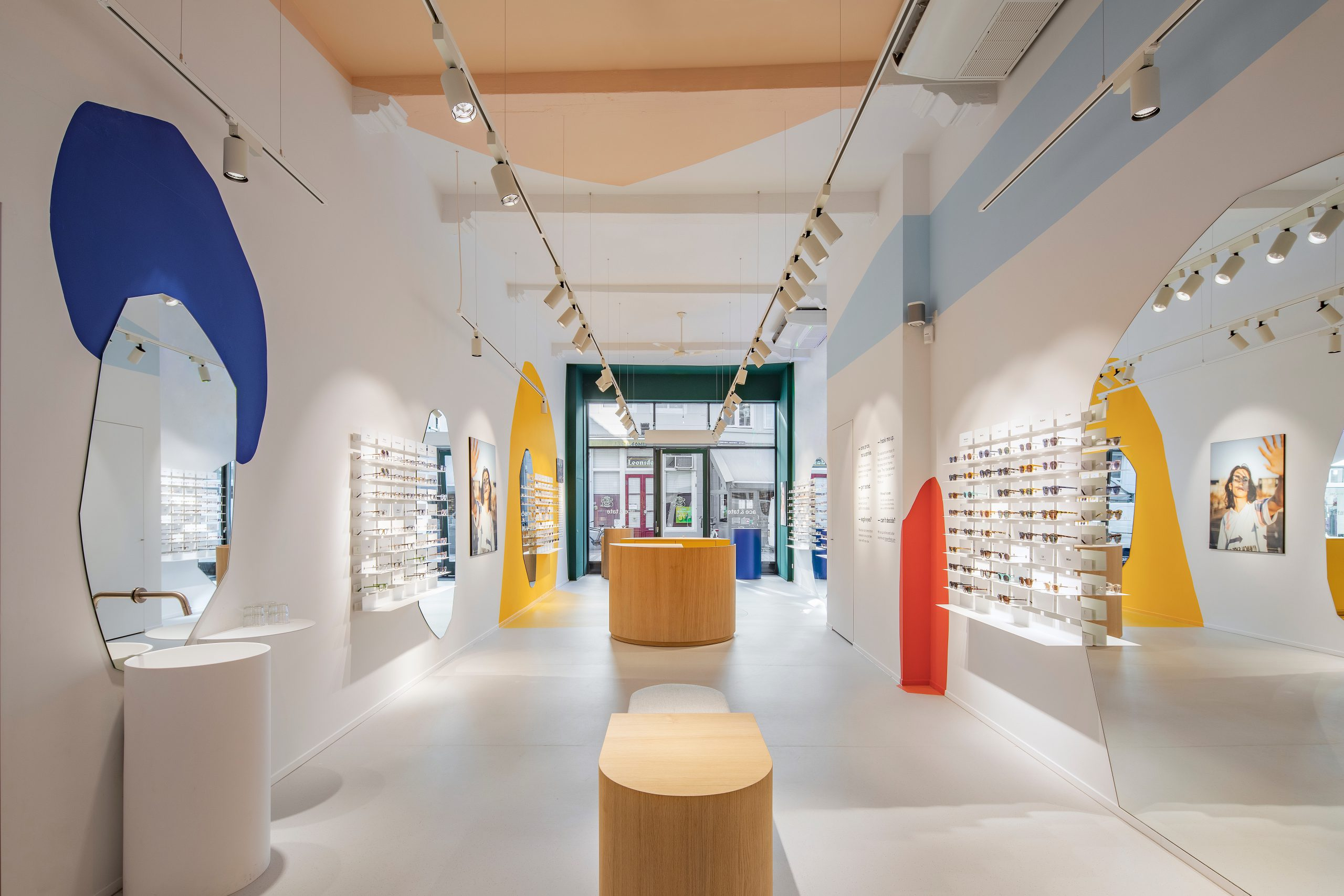 Interior of an eyeglasses store, decorated in reference to the paintings of Hieronymus Bosch