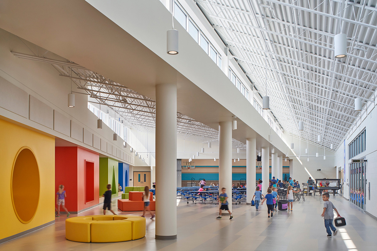 Image of sunlight interior with high ceiling and furniture featuring basic shapes for kids