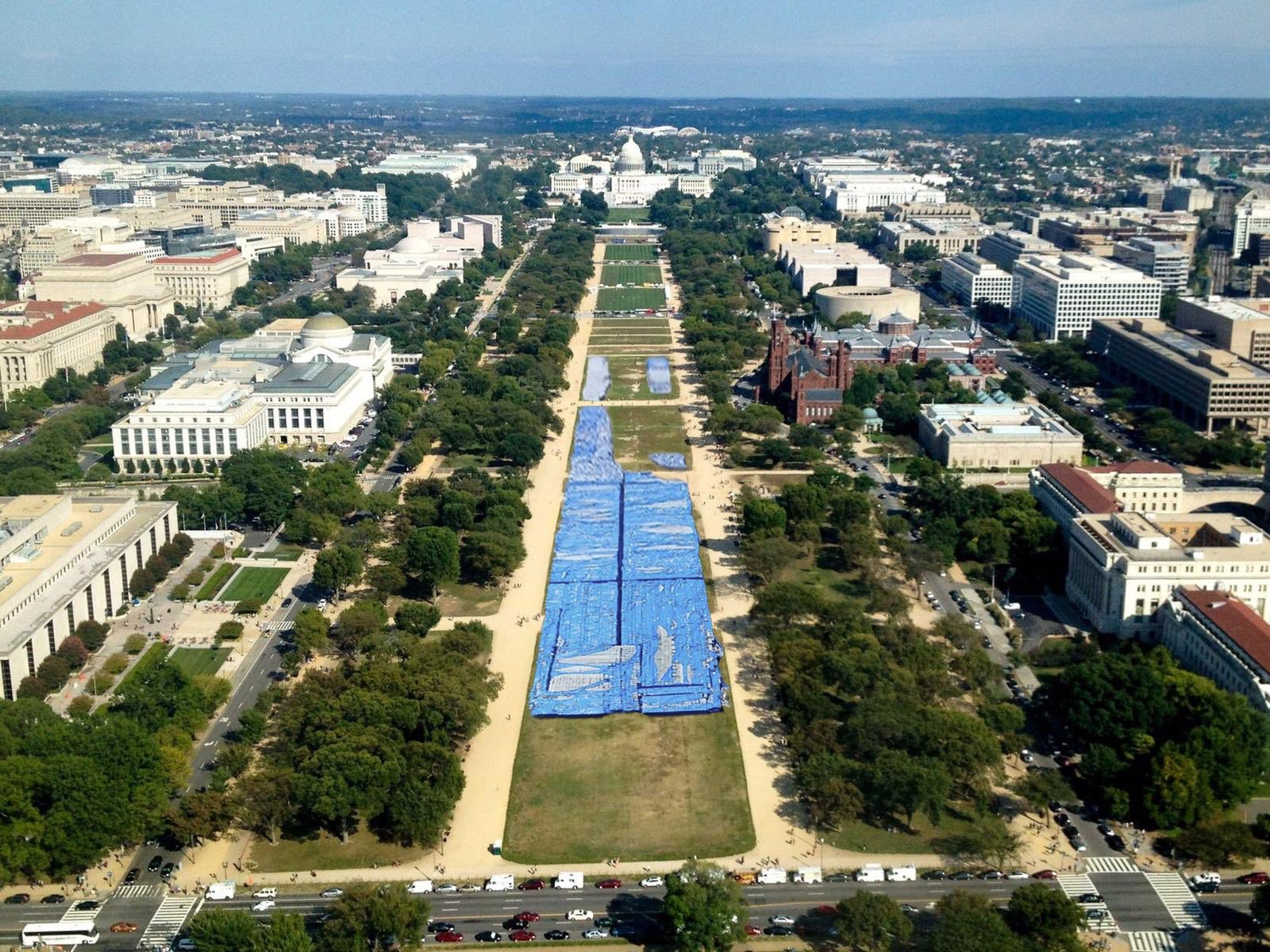 Photomontage of aerial view of National Mall with tarps laid on lawn