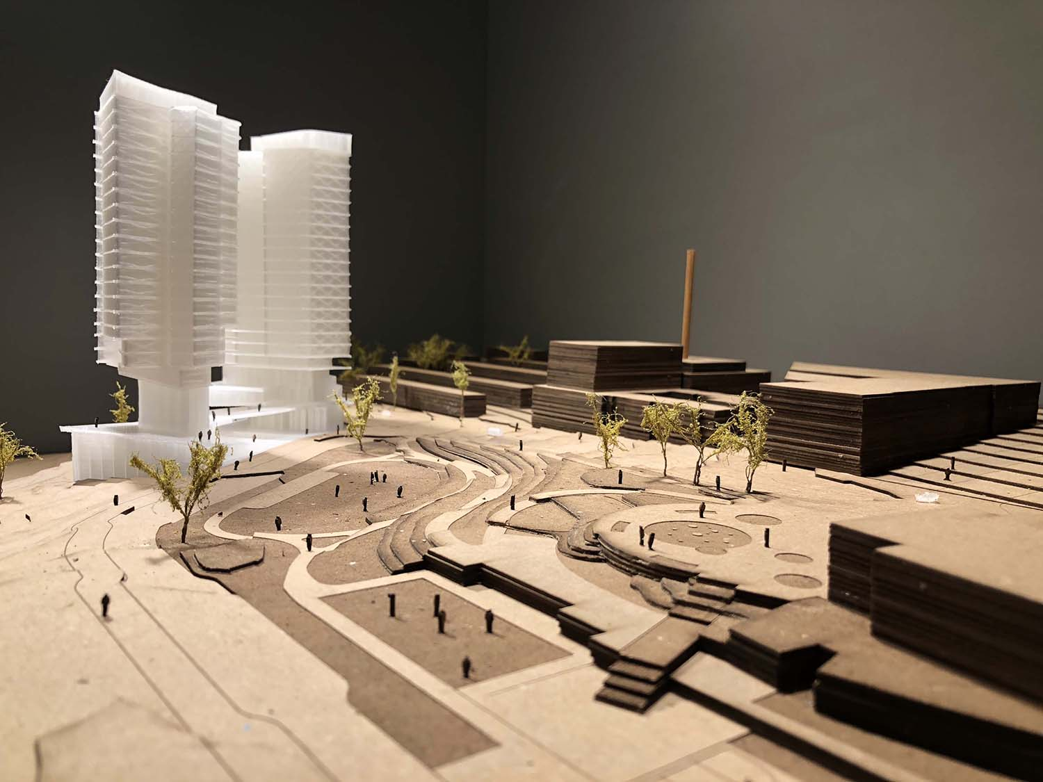 Model of a white tower in a cardboard landscape, presented by the Seattle Architecture Foundation