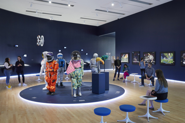 Interior of a gallery with spacesuits