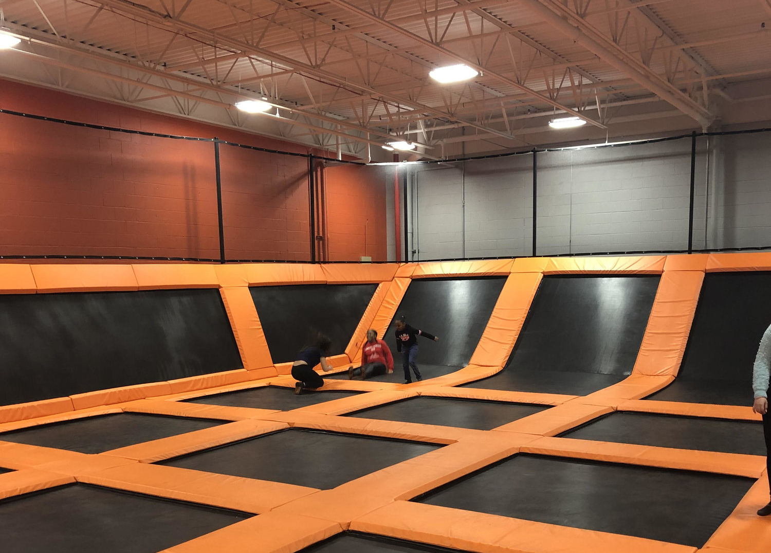 Image of kids bouncing on wall to wall trampolines