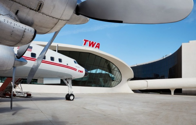 View of TWA Hotel next to Flight Center with Connie airplane on tarmac