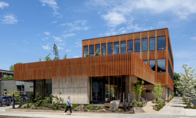 Photo of a low-slung building wrapped with vertical timber louvers, The Nature's Conservancy's new headquarters