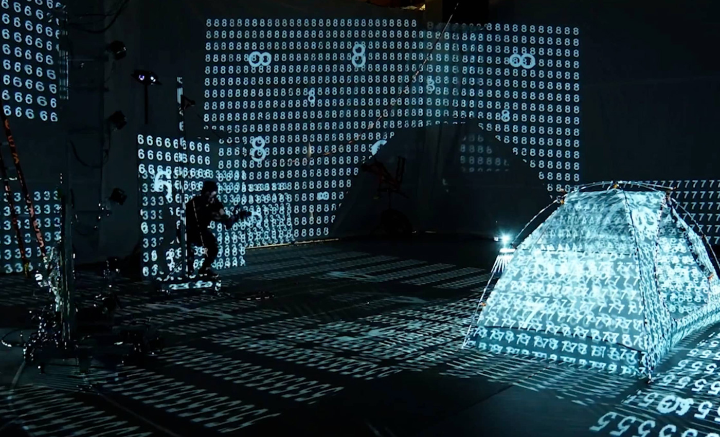 Photo of a man in front of a tent with code in augmented reality