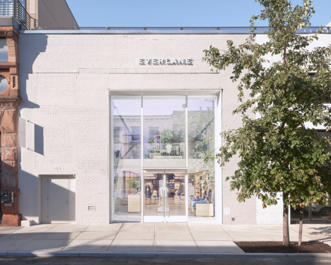 """A white brick building with an """"Everlane"""" sign"""