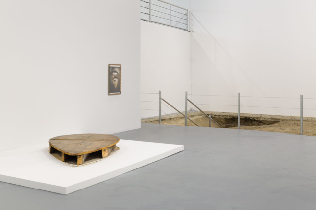 View of a white gallery with a hole in the background