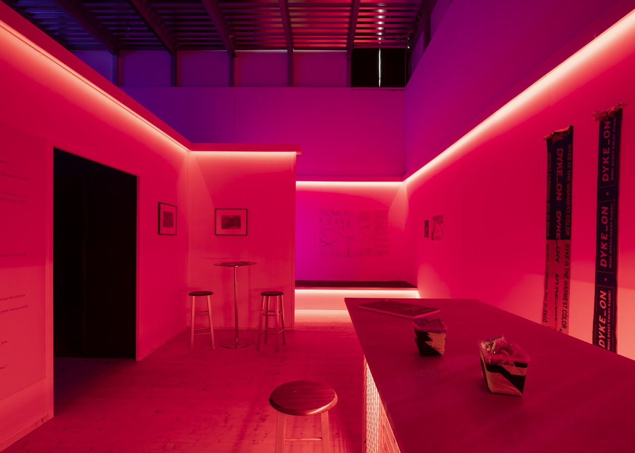 Interior of the Cruising Pavilion, presenting a dark, red room