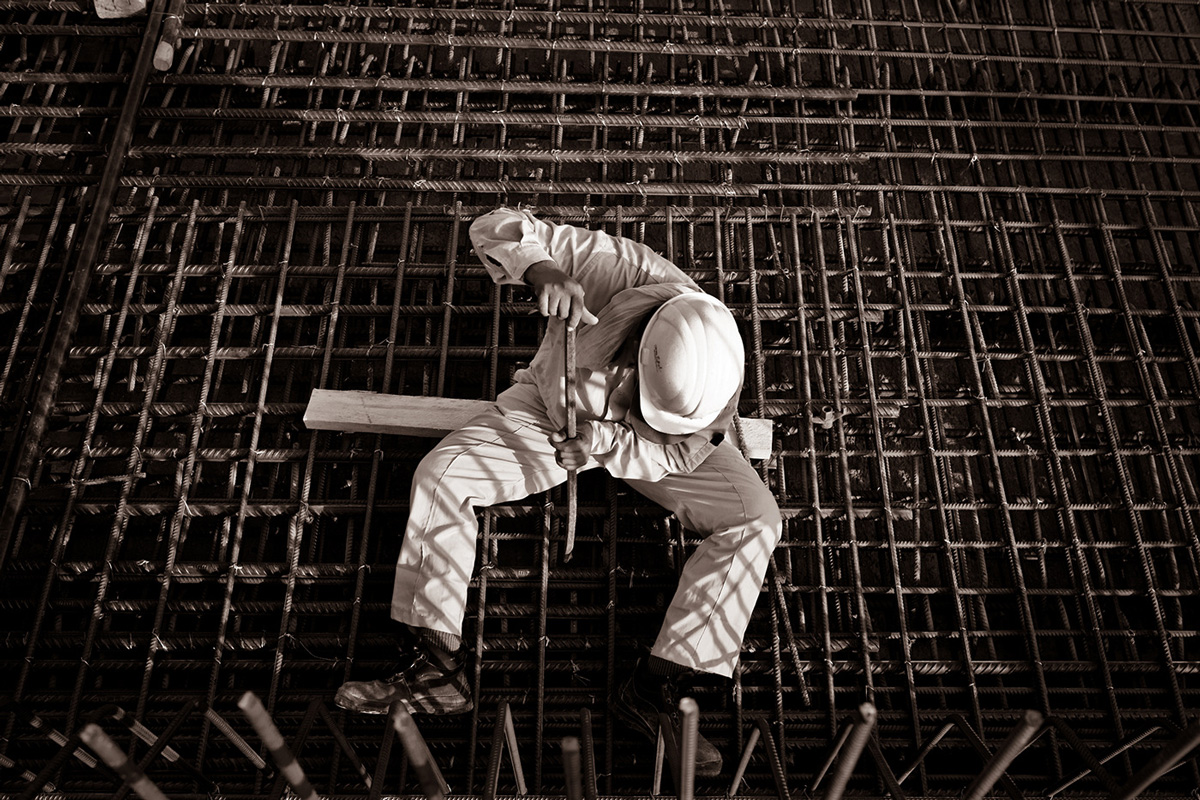 Aerial image of construction worker sitting on steel beams