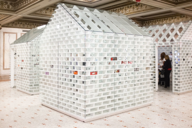 "White ""houses"" installed inside a Beaux Arts interior for the 2019 Chicago Architecture Biennial"