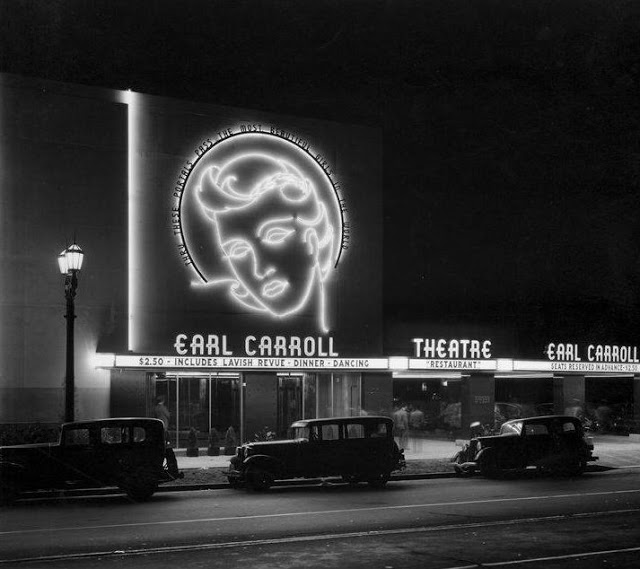 A black and white photo of a theater with the words