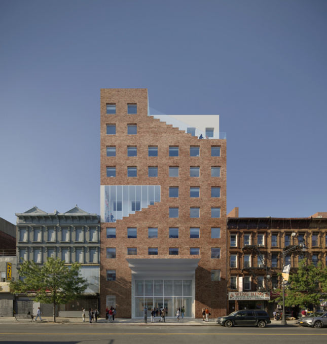 Rendering of a red brick tower, the new Brooklyn home of The Collective