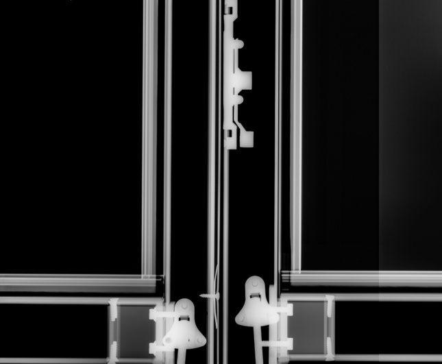 X-ray of screws mounting panels to a wall