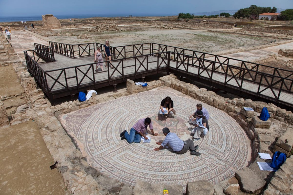 Participants in the 2014 MOSAIKON course Conservation and Management of Archaeological Sites with Mosaics conduct a condition survey exercise of the Theseus Mosaic at the archaeological site of Nea Paphos, Paphos, Cyprus. Part of the Getty conservation effort.