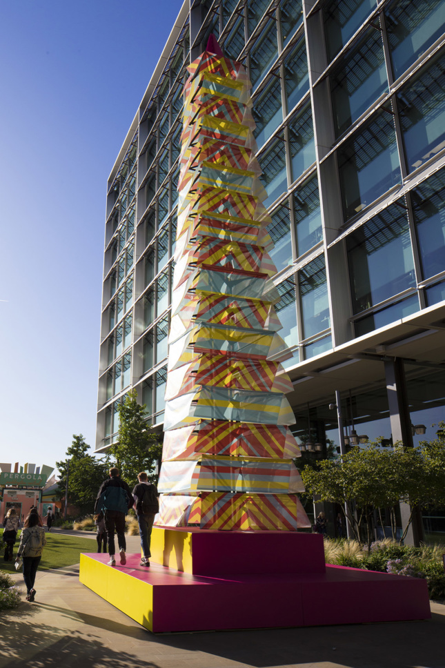 A billowing fabric tower in multiple colors as part of the London Design Festival