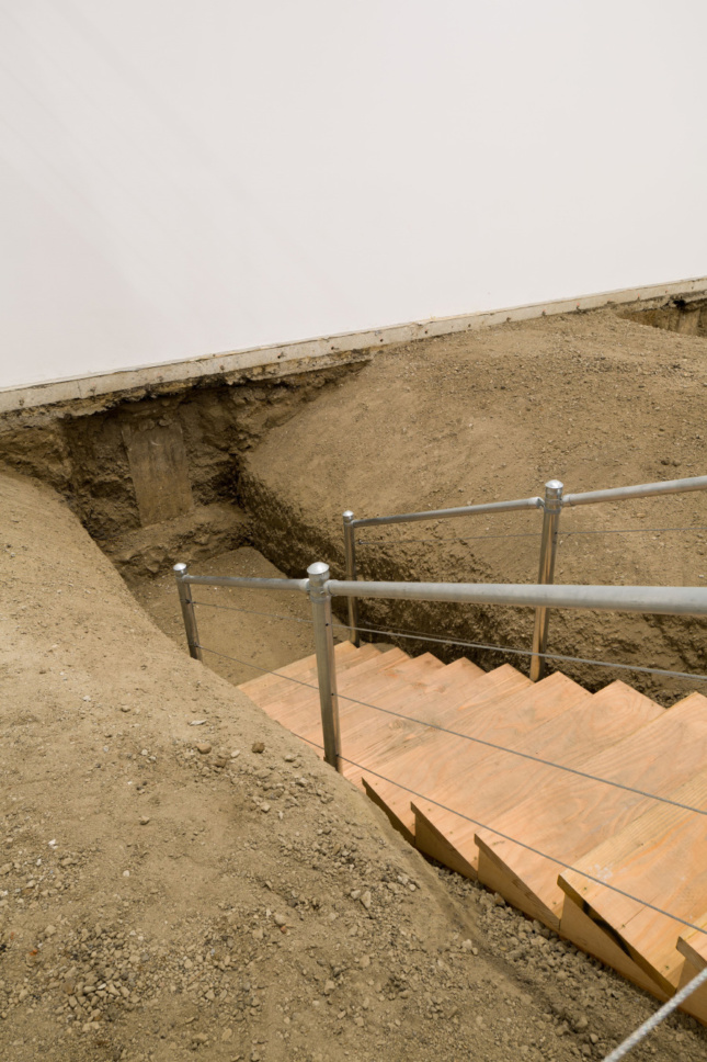 A stairway descending into a hole
