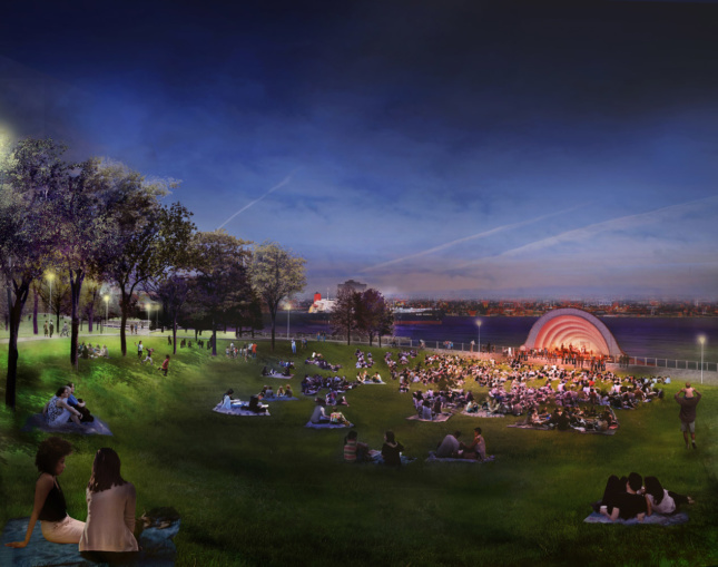 A render of a curved stage lit in orange in front of water with a large populated lawn in front.