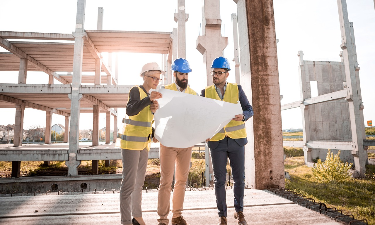 Image of architects standing on construction site, illustrating the Architecture Billings Index somehow