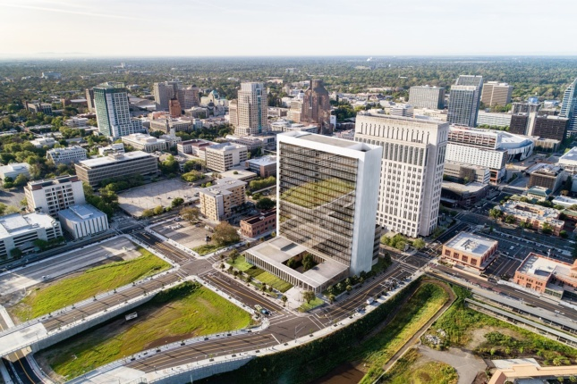 Aerial rendering of glass-facade courthouse with street and landscape surrounding