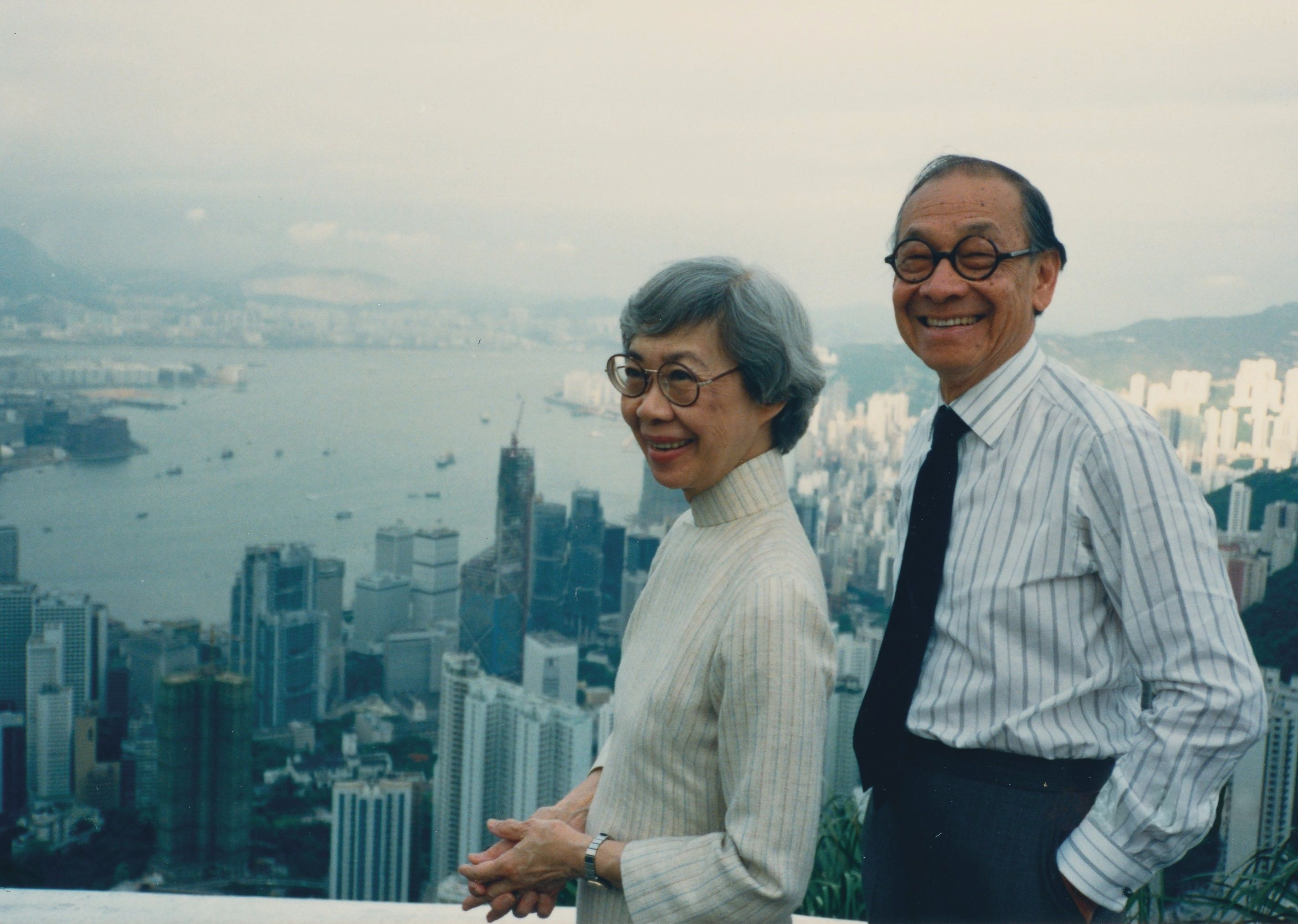 A photo of a man, I.M. Pei, and woman against a skyline