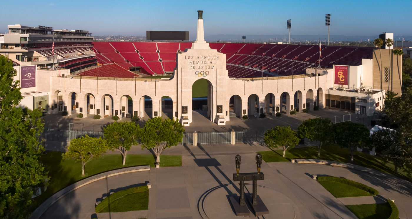 Photo of the Los Angeles Coliseum, featuring red seats around a field