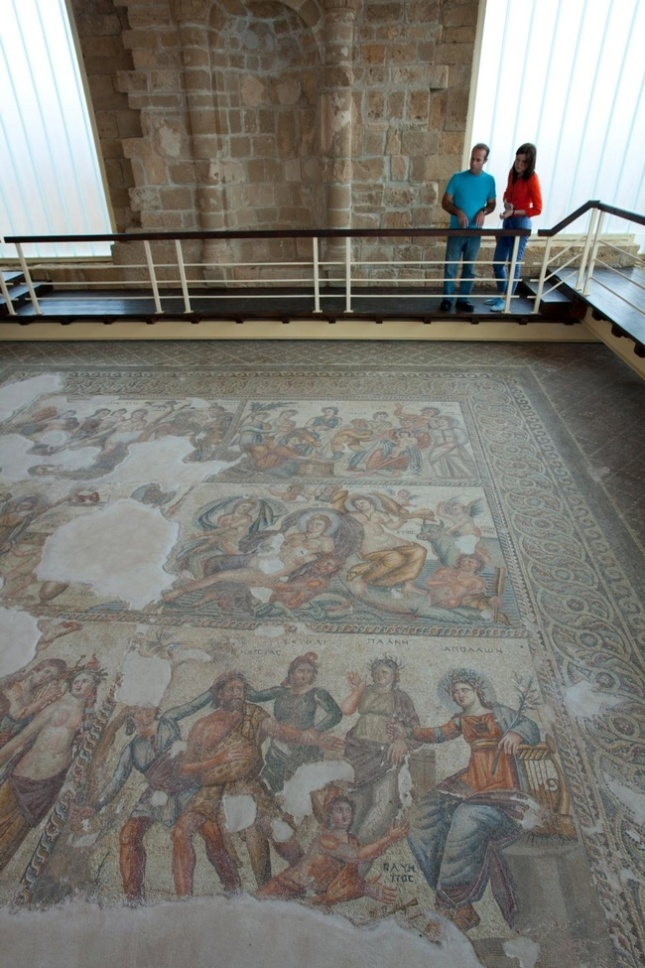 People looking at a mosaic floor