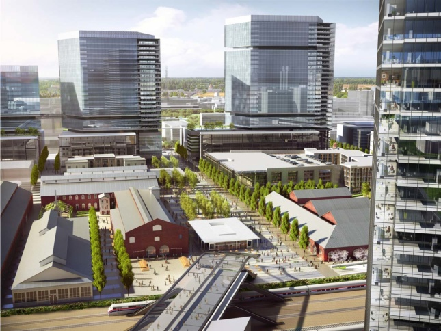 Aerial rendering of mixed-use development with red brick structures surrounded by new glass towers
