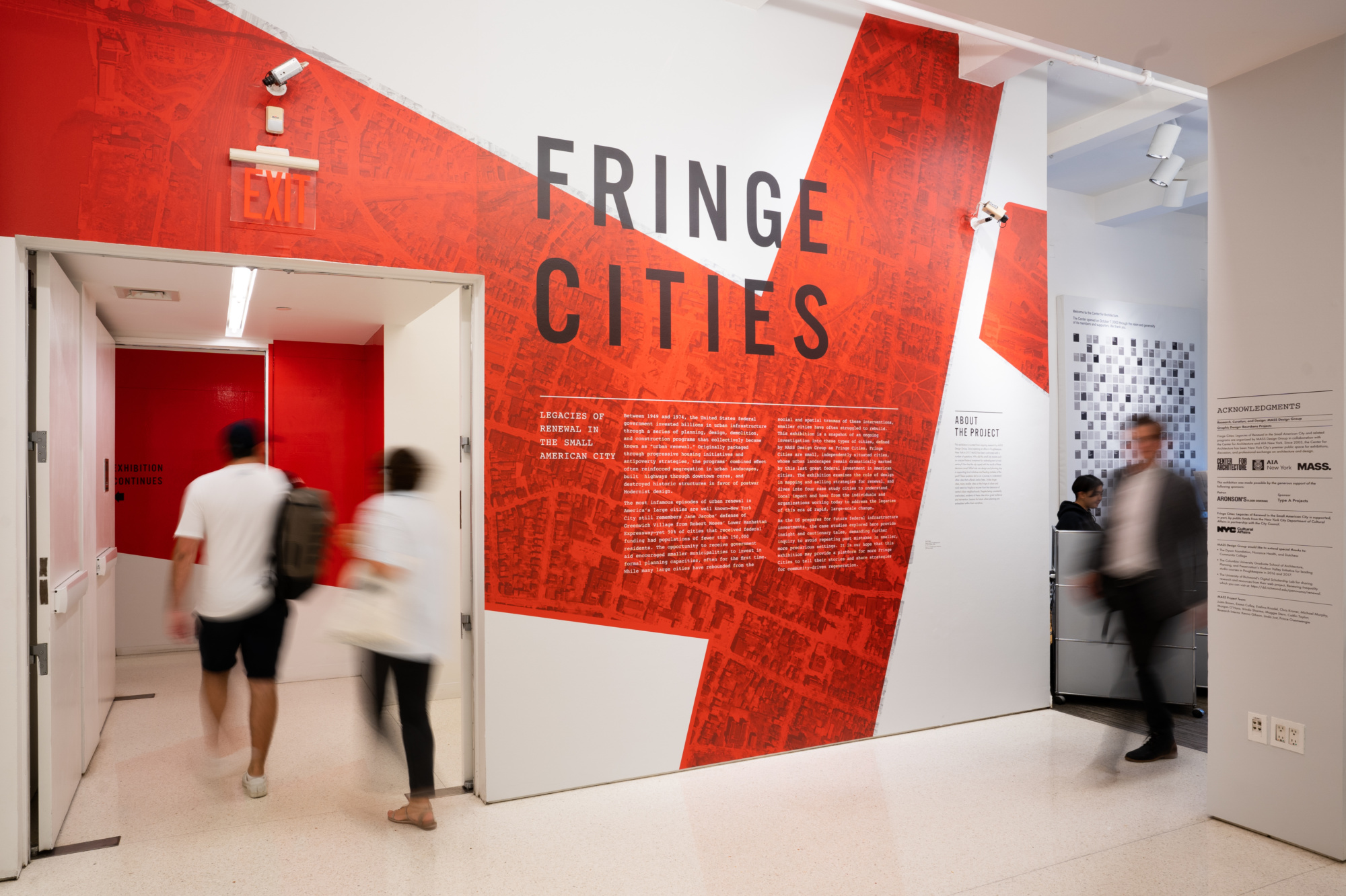A white wall with the words FRINGE CITIES in red text